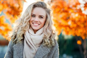 Beautiful Smiling Blond Woman With Curly Hair And Blue Eyes Ok Dental Expressions Blog