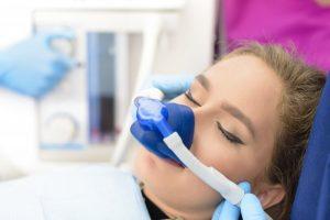 woman receiving nitrous oxide sedation