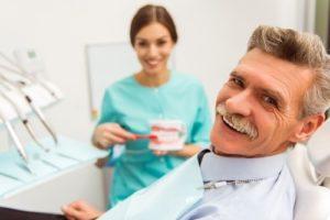 Man at dental checkup with dentures
